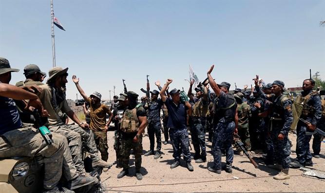 las-fuerzas-anti-isis-celebran-en-irak-despues-de-tomar-posicion-yihadista-reuters