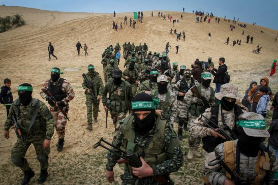 Members of the Ezzedine al-Qassam Brigades, the military wing of the Palestinian Islamist movement Hamas, attend a memorial in the southern Gaza Strip town of Rafah.